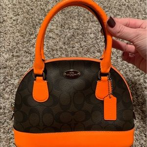Small Orange and Brown Coach Handbag